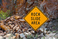 Rock Slide Area Sign with Fallen Rocks Stock Photo