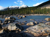Rock slide on frozen lake Stock Images