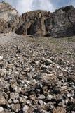 Rock slide under cliff stock images