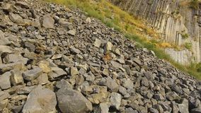 Rock slides and stones scattered over hills, risk of mudflow, geology science. Stock footage stock footage