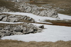 Rock with snow on the Plateau. Of the Crimean mountains Royalty Free Stock Photo