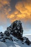 Rock, snow and sky. Stock Photos