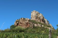 Rock of Solutré. Photography showing the Rock of Solutré. The Rock of Solutré is a limestone overlooking the village of Solutré-Pouilly near the city of M stock photography