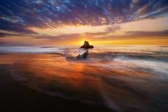 Rock in Sopelana beach at sunset Stock Photos