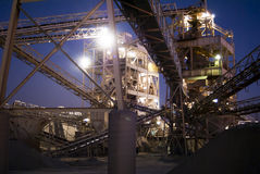 Rock Sorting Machines. Conveyor belts and platforms of rock sorting machines at dusk Royalty Free Stock Photos