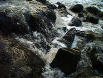 Rock spa. Rushing water over rocks royalty free stock photography