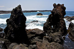 Rock spain   beach water  in lanzarote  isle foam  landscape  st Royalty Free Stock Images