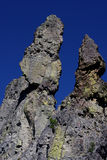 Rock spires against blue sky Royalty Free Stock Photography