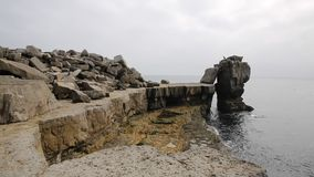 Rock stack by Portland Bill Lighthouse on the Isle of Portland Dorset England UK stock footage