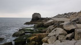 Rock stack and rocky coast by Portland Bill Lighthouse on the Isle of Portland Dorset England UK stock footage