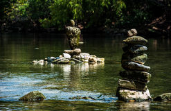 Rock Stacking Zen Formation in river. In the barton springs pool area of Austin , Texas. Right off of the colorado river stacking rocks for a tranquil calm Royalty Free Stock Images