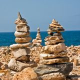 Rock Stacks. Stacks of rocks for luck, on a rocky beach Royalty Free Stock Images