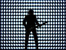 Rock star. A rocker silhouette with his guitar Royalty Free Stock Image