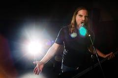 Rock star. Guitarist singing stage Stock Image