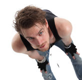 Rock star. Wearing a tank top and jewellry. White background Stock Images