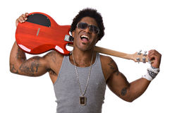 Rock star. Handsome African-American male rock star with an electric guitar Royalty Free Stock Images