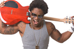 Rock star. Handsome African-American male rock star with an electric guitar Royalty Free Stock Image