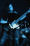 Rock Star. Playing guitar under blue lights Stock Images