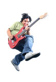 Rock Star. Young guy jumping with guitar Stock Photography