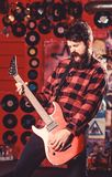 Rock star concept. Musician with beard play electric guitar. royalty free stock photos