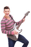 Rock star with an electric guitar Stock Photo