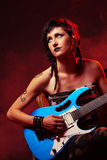 Rock star. Female guitarist playing guitar at a rock concert Stock Images