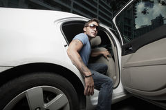 Rock star getting out of his car Royalty Free Stock Photography
