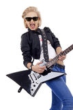Rock star girl with sunglasses. Playing an electric guitar Stock Images