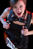 Rock star holding her electric guitar. sexy girl Stock Image