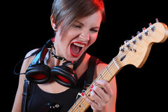 Rock star holding her electric guitar. sexy girl. Rock star holding her electric guitar. headphones Stock Photos