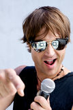 Rock Star Jamming Out. A Rock Star Jamming out with a microphone Stock Image