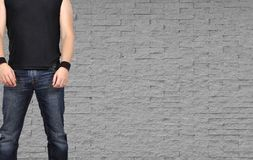 Rock star men standing on brick wall backgraund Stock Image