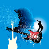 Rock star performing with guitar on abstract background Royalty Free Stock Photography