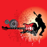 Rock star performing with guitar on abstract background Stock Images
