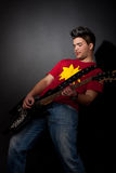 Rock star playing solo Stock Photo
