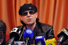 Rock star at press conference Royalty Free Stock Image