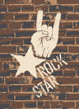 Rock Star Sign With Horns Gesture On Brick Wall Royalty Free Stock Photography