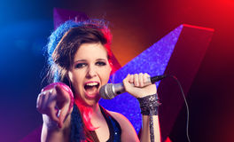 Rock star singing on stage Royalty Free Stock Images
