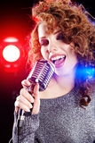 Rock star. Woman  singing in retro mic Royalty Free Stock Photo