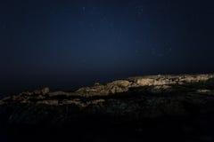 Rock. starry night sky. sea. royalty free stock image