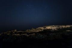 Rock. starry night sky. sea. stock image