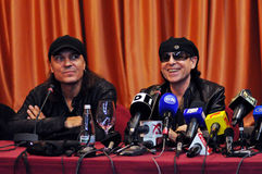 Rock stars at press conference Stock Image