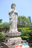 Rock statue of god in Korea Royalty Free Stock Image