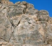 Rock statue of hero Hercules built in 148 BC at Bisotun, Iran. Royalty Free Stock Photo