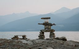 Rock Statue with Mountain Background royalty free stock images