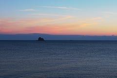 Rock sticking out of the sea. Tyrrhenian Sea. Marina di Patti. Sicily Stock Photos