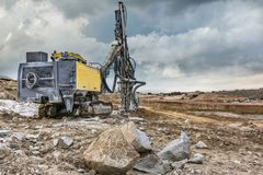 Rock and stone drilling in a building site royalty free stock images