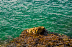 Rock, stone and emerald seawater. Polignano a Mare, Italy Stock Photo