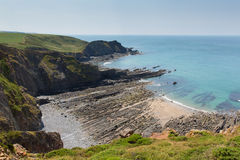 Rock strata in rocky beach cove Royalty Free Stock Photo