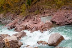 Rock in stream flow of mountains river fall season Stock Images